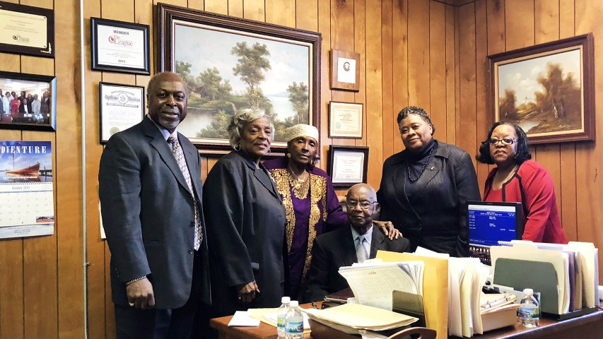 Board members of the Greater Galilee Missionary Baptist Church Credit Union gather in the credit union's office in Milwaukee on Oct. 21, 2018. Board members are Ed Murphy, from left, Jynette Hamilton, Gloria Neff, William Coffer, Ella Dunbar and Vinia Neal. The group runs the credit union on a volunteer basis. RNS photo by Katelyn Ferral