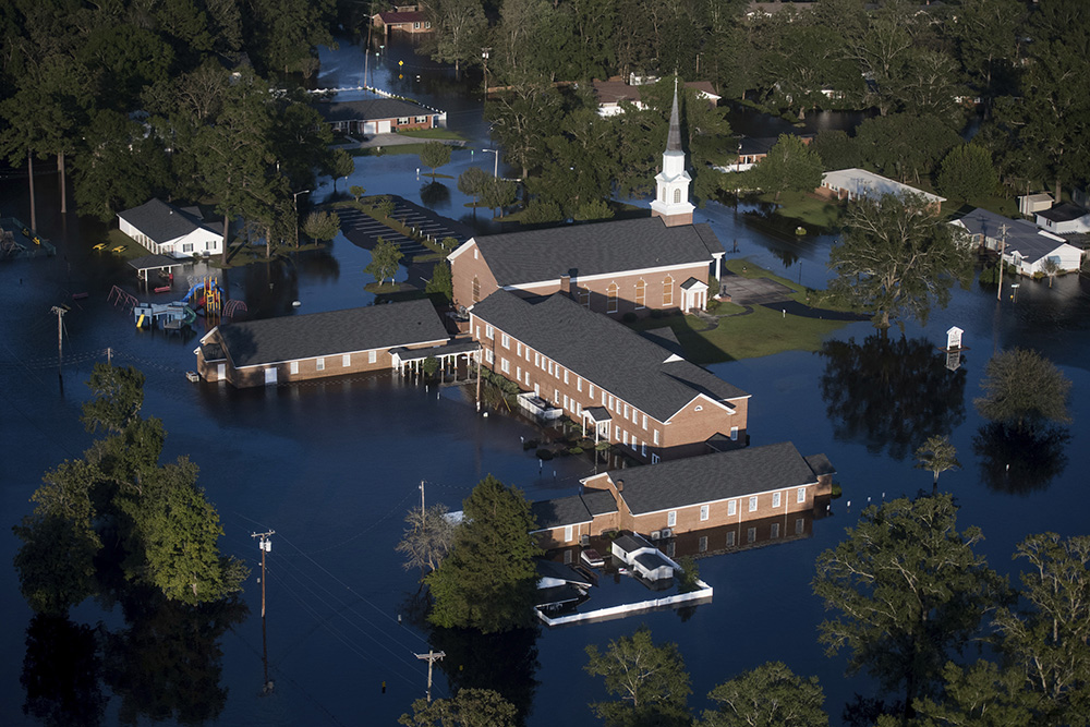 Floodwaters inundate a church after Hurricane Florence struck the East Coast on Sept. 17, 2018, in Conway, S.C. (AP Photo/Sean Rayford)