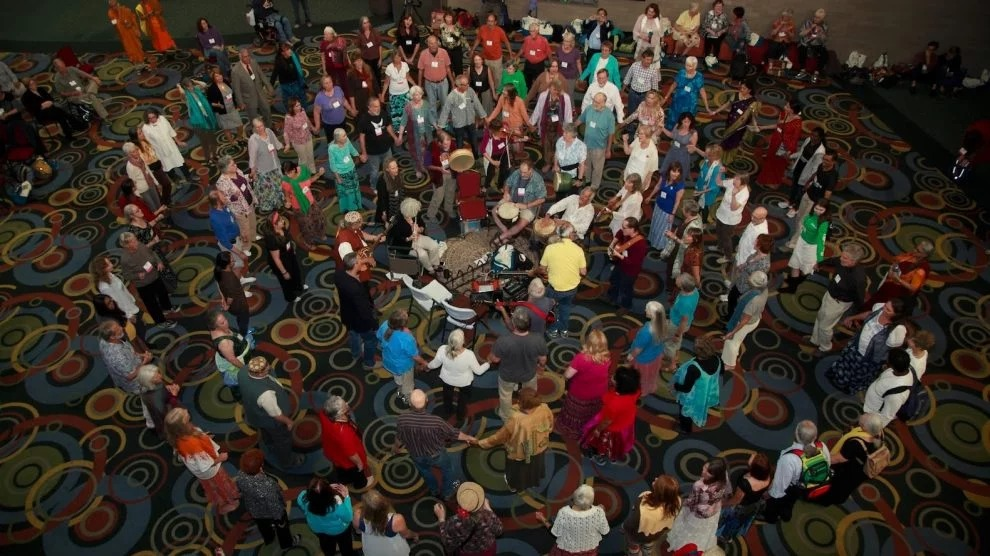 A drumming circle pulls dancers together at a Dances of Universal Peace even at the 2015 Parliament of the World's Religions in Salt Lake City, Utah. (Credit: Parliament of the World's Religions)