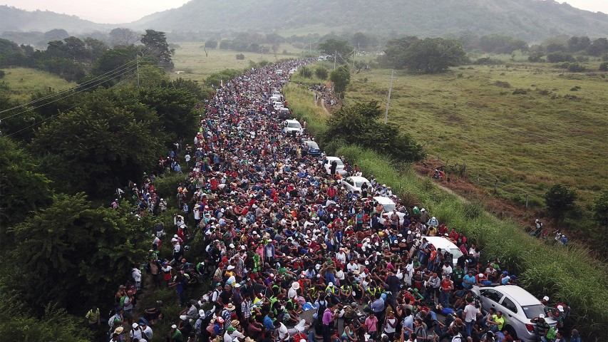 Members of a U.S.-bound migrant caravan stand on a road after federal police briefly blocked their way outside the town of Arriaga, Mexico, on Oct. 27, 2018. Hundreds of Mexican federal officers carrying plastic shields had blocked the caravan from advancing toward the United States after several thousand of the migrants turned down the chance to apply for refugee status and obtain a Mexican offer of benefits. (AP Photo/Rodrigo Abd)