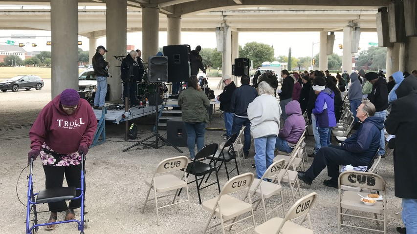 A woman wears a TROLL Church Under the Bridge hoodie as poor and homeless congregants participate in a service at Church Under the Bridge in Waco, Texas, on Nov. 18, 2018. RNS photo by Bobby Ross Jr.