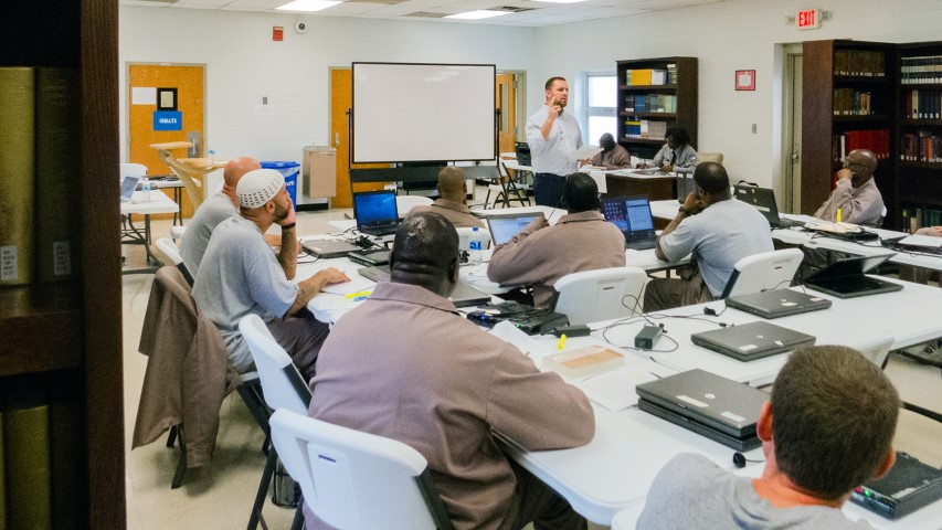Jamie Dew, dean of the college at Southeastern Baptist Theological Seminary, teaches a theology class to inmates at Nash Correctional Institution in Nashville, N.C. RNS photo by Sam Morris