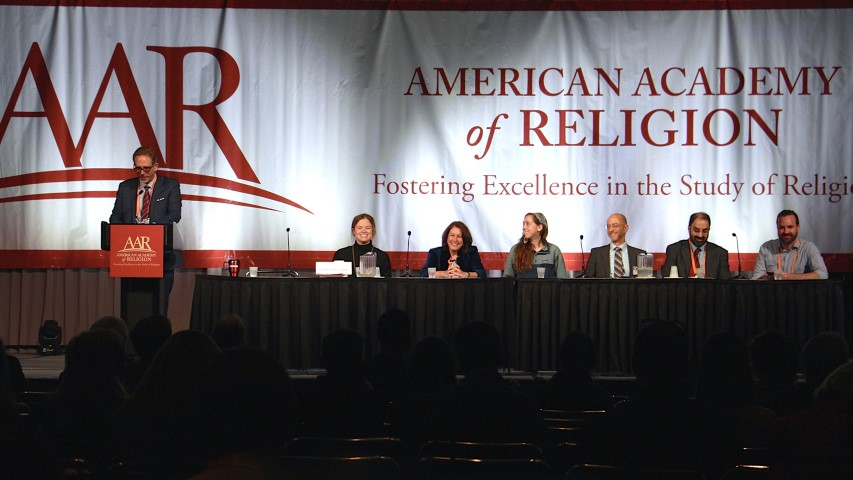 "AAR President David Gushee, left, moderates a plenary panel titled ""Religion Journalism and Religion Scholars: To 2020 and Beyond"" on Nov. 17, 2018, at the start of the American Academy of Religion annual meeting in Denver. Panelists include (left to right) Elizabeth Dias and Laurie Goodstein, both of the New York Times; Emma Green of The Atlantic; Jerome Socolovsky of National Public Radio; Niraj Warikoo of the Detroit Free Press; and Jeremy Weber of Christianity Today. RNS photo by Emily McFarlan Miller"