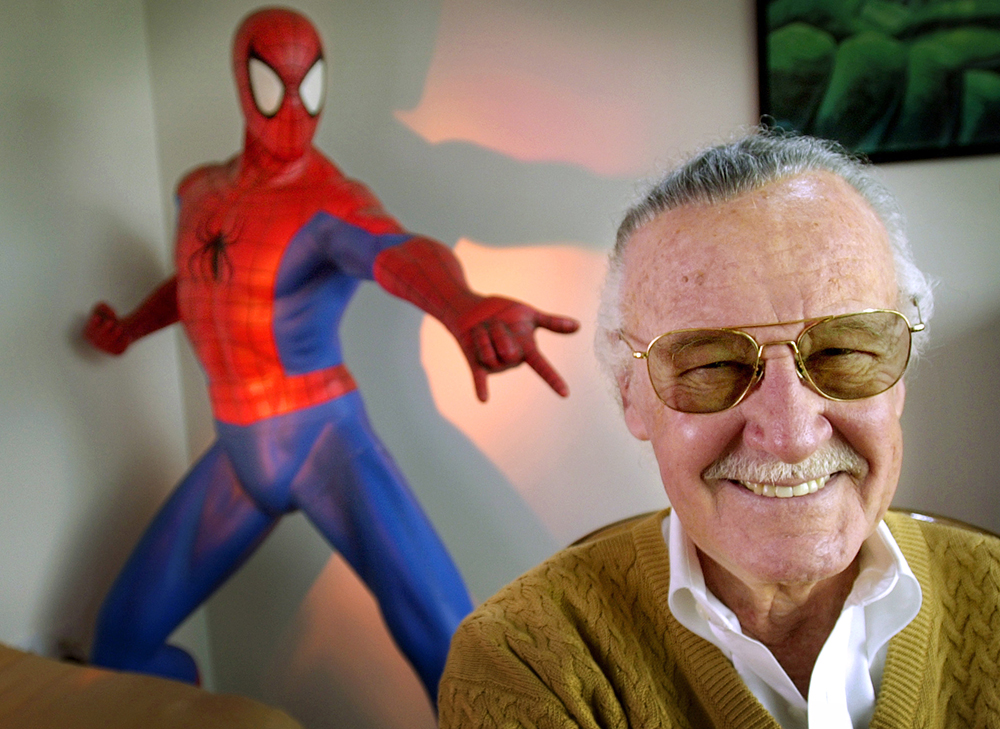 """Stan Lee, creator of comic-book franchises such as """"Spider-Man,"""" """"The Incredible Hulk"""" and """"X-Men,"""" smiles during a photo session in his office in Santa Monica, Calif, in 2002. Lee, the architect of the contemporary comic book, died at the age of 95. (AP Photo/Reed Saxon)"""