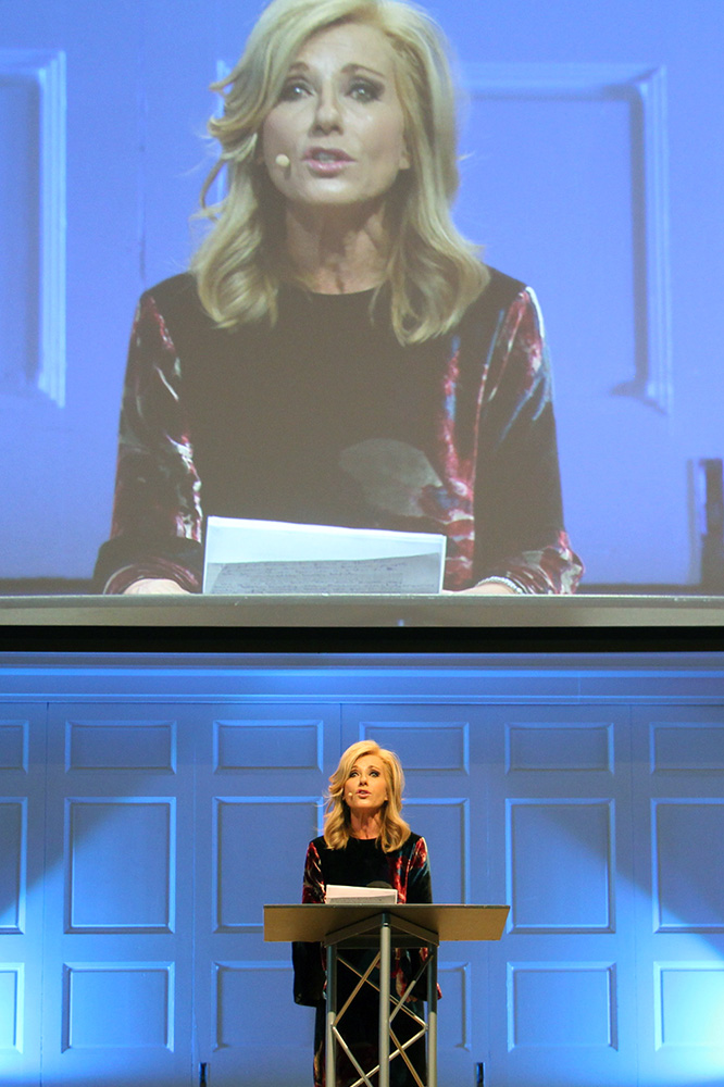 Beth Moore addresses participants at Wheaton College on Dec. 13, 2018, at a summit on sexual abuse and misconduct. RNS photo by Emily McFarlan Miller