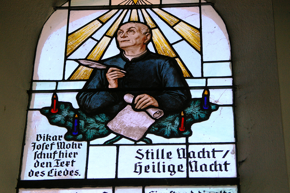 "A stained-glass window of Joseph Mohr, the author of the ""Silent Night"" poem, at the Silent Night Chapel in Oberndorf, Austria. Photo courtesy of Creative Commons"