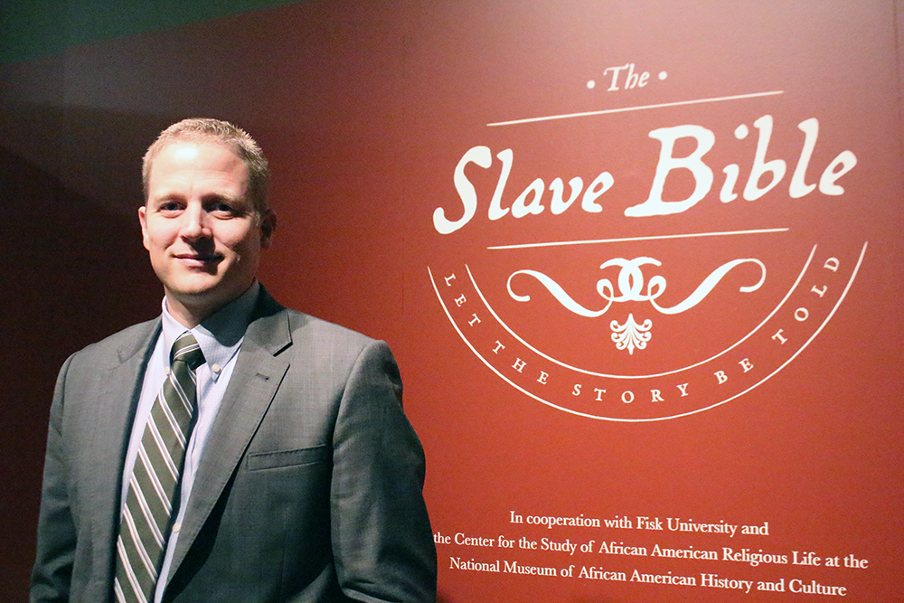 Seth Pollinger, director of museum curatorial, at the Slave Bible exhibit. RNS photo by Adelle M. Banks