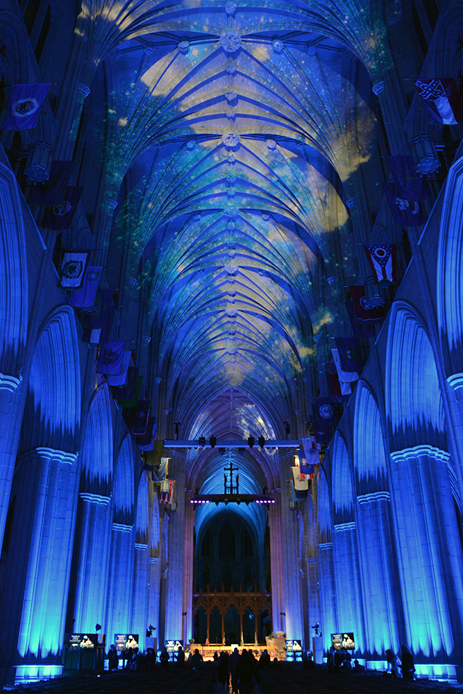 Projectors illuminate the ceiling of the Washington National Cathedral scenes of the cosmos on Dec. 11, 2018. RNS photo by Jack Jenkins