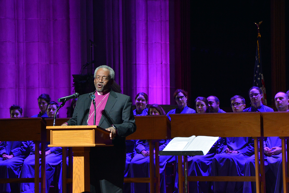 Presiding Bishop of the Episcopal Church Michael Curry addresses the gathering at the Washington National Cathedral on Dec. 11, 2018. RNS photo by Jack Jenkins