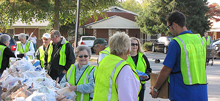Westhaven Baptist Church members assist with food distribution. The local food bank used to use the church as a drop-off point.