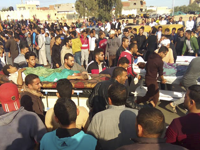 Injured people are evacuated from the scene of a militant attack on a mosque in Bir al-Abd in the northern Sinai Peninsula of Egypt on Friday, Nov. 24, 2017. In the deadliest-ever attack by Islamic extremists in Egypt, militants assaulted a crowded mosque Friday during prayers, blasting helpless worshippers with gunfire and rocket-propelled grenades and blocking their escape routes. More than 200 people were killed before the assailants got away. (AP Photo)