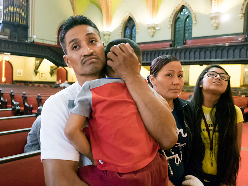 Javier Flores, an undocumented Mexican man facing deportation, sought and received sanctuary in the Arch Street United Methodist in Philadelphia, Penn. Flores cradles his 4-year-old son Javier, with his wife Alma and daughter Adamaris standing by his side, inside the Arch Street United Methodist Church where he was granted sanctuary on Nov.13, 2016. Photo courtes of Philly.com/Ed Hille