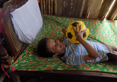 A bedridden boy in Nicaragua responds in joy when Cresthill Baptist Church in Bowie, Md., volunteers ministered to him and other families with special needs. Baptist Convention of Maryland/Delware photo