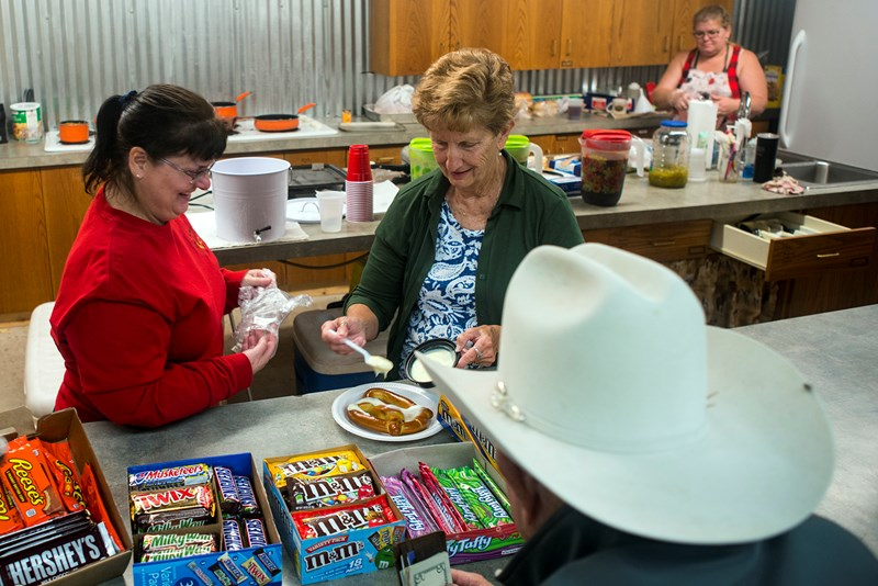 Sherry Mayberry (left) works in the kitchen with other volunteers at Three Wooden Crosses. She and her husband Don, bivocational pastor of the cowboy church, spend many evenings and most weekends in ministry since they also hold second jobs. (Photo: Sue Sprenkle)