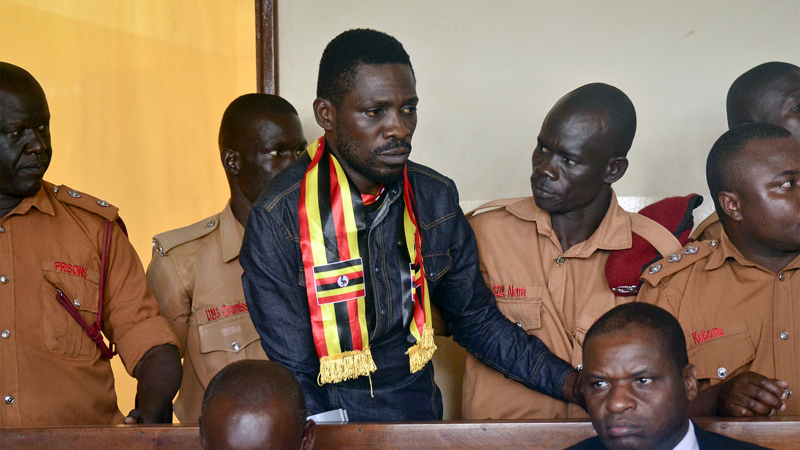 Ugandan pop star-turned-lawmaker Robert Kyagulanyi Ssentamu, also known as Bobi Wine, center, arrives at a magistrate's court in Gulu, northern Uganda, on Aug. 23, 2018. Wine, who opposes longtime President Yoweri Museveni, was charged with treason in the civilian court in Gulu, minutes after a military court dropped weapons charges. (AP Photo)