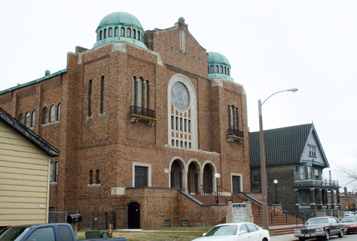 The Greater Galilee Credit Union is run out of the Greater Galilee Missionary Baptist Church in Milwaukee. The building, which housed Congregation Beth Israel Synagogue until 1960, was listed on the National Register of Historic Places in 1992. Photo courtesy of Creative Commons
