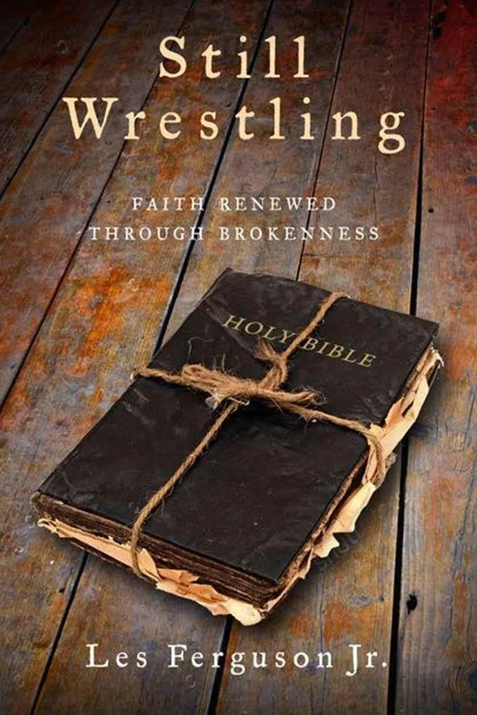"""Still Wrestling: Faith Renewed Through Brokenness"" by Les Ferguson Jr. explores questions of faith and doubt that consumed the Mississippi minister after his wife and disabled son were slain in 2011. Image courtesy of Leafwood Publishers"