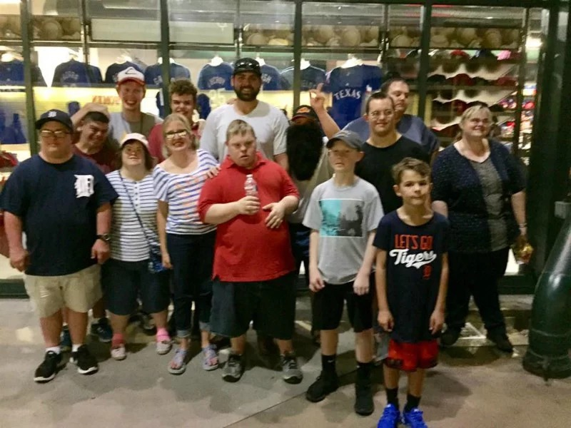Members of Wings, a Christian nonprofit that offers social, vocational and residential programs for adults with developmental disabilities, pose with Detroit Tigers pitcher Michael Fulmer after a game at Globe Life Park in Arlington, Texas, in August 2017. Photo provided by Randy Webb
