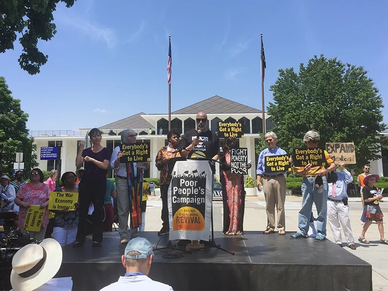 Derick Smith, a political education coordinator for the Poor People's Campaign, speaks to the crowd in Raleigh, N.C., on May 14, 2018 in front of the state legislature building. Coordinated events occurred at many state capitols across the country. RNS photo by Yonat Shimron