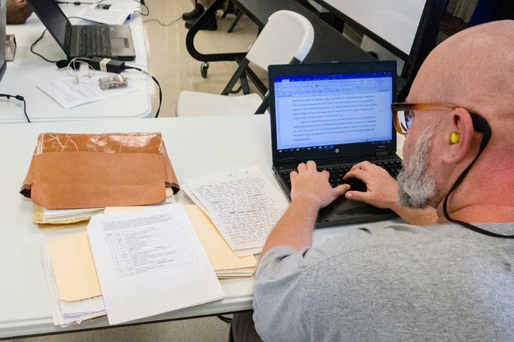 An inmate at Nash Correctional Institution works on material for a theology class in Nashville, N.C. RNS photo by Sam Morris
