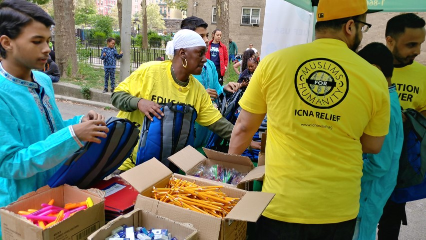 Volunteers organize supplies during an event with the Islamic Circle of North America's back-to-school drive in Hempstead, N.Y., on Sept. 2, 2017. Photo courtesy Shahid Farooqi