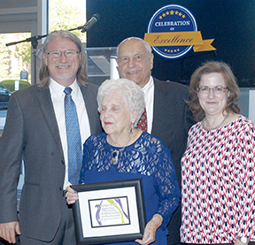 Wil and Louise Duke (center) display the Celebration of Excellence Award presented to them by fellow Kirkwood Baptist Church members Doug (left) and Darla Gavin.
