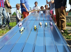 Students enjoy racing the pinewood derby cars they constructed from kits. A team from Cooperative Baptist Fellowship Heartland introduced the cars on their latest trip to Slovakia, where they worked at a school and with children from a nearby Roma (Gypsy) settlement. The car construction and racing allowed students to practice English and opened relationships. (Photo by Matt Thompson)