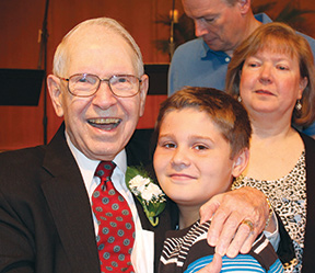 Don Wideman gets a hug from great-grandson Kaden Miller during a celebration honoring him and his wife Marian last summer. Behind them is the Wideman's daughter Becky and her husband, Brian. (Sally Wideman)