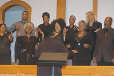 Members of Metropolitan Missionary Baptist Church's adult choir lead Churchnet attendees in worship during the organization's annual gathering at First Baptist Church, Lee's Summit, Mo., whose musicians led another worship service. (Bill Webb)