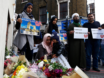 Muslims pray at a floral tribute near London Bridge, after attackers rammed a hired van into pedestrians on London Bridge and stabbed others nearby killing and injuring people, in London on June 3, 2017. Photo courtesy of Reuters/Peter Nicholls