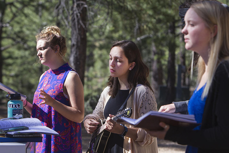 From left, Meleeza Hall, Gabi Sheeley and Amy Auble sing worship songs in Bryce Canyon National Park on June 18, 2017. Photo courtesy of Deseret News/Kelsey Brunner