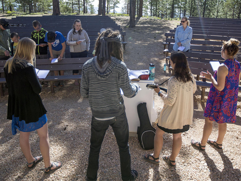 Attendees sing worship songs during the 9:30 a.m. nondenominational Christian church service in an outdoor amphitheater in Bryce Canyon National Park on June 18, 2017. Photo courtesy of Deseret News/Kelsey Brunner