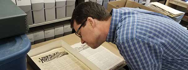 Brian Kaylor looking at the first issue of Word&Way. (Ken Satterfield/Word&Way)