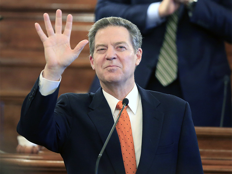 Kansas Gov. Sam Brownback waves to guests before delivering his State of the State address to a joint session of the Kansas Legislature in Topeka on Jan. 10, 2017. (AP Photo/Orlin Wagner)