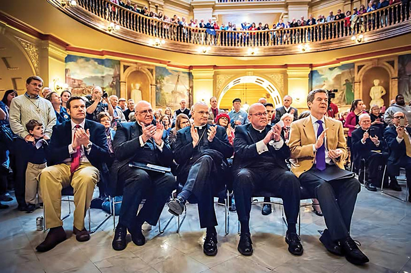 Kansas Gov. Sam Brownback, at far right, and three bishops attend the religious freedom rally on Feb. 17, 2016, in Topeka, Kan. Archbishop Joseph F. Naumann of Kansas City, from left, Bishop Edward J. Weisenburger of Salina, and Bishop Carl A. Kemme, of Wichita attended with Brownback. Photo courtesy of Joe Bollig/The Leaven