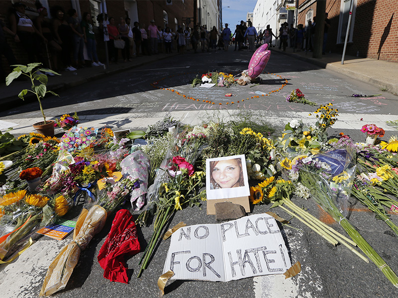 A makeshift memorial of flowers and a photo of victim Heather Heyer sits in Charlottesville, Va., on Aug. 13, 2017. Heyer died when a car rammed into a group of people who were protesting the presence of white supremacists who had gathered in the city for a rally. AP Photo/Steve Helber
