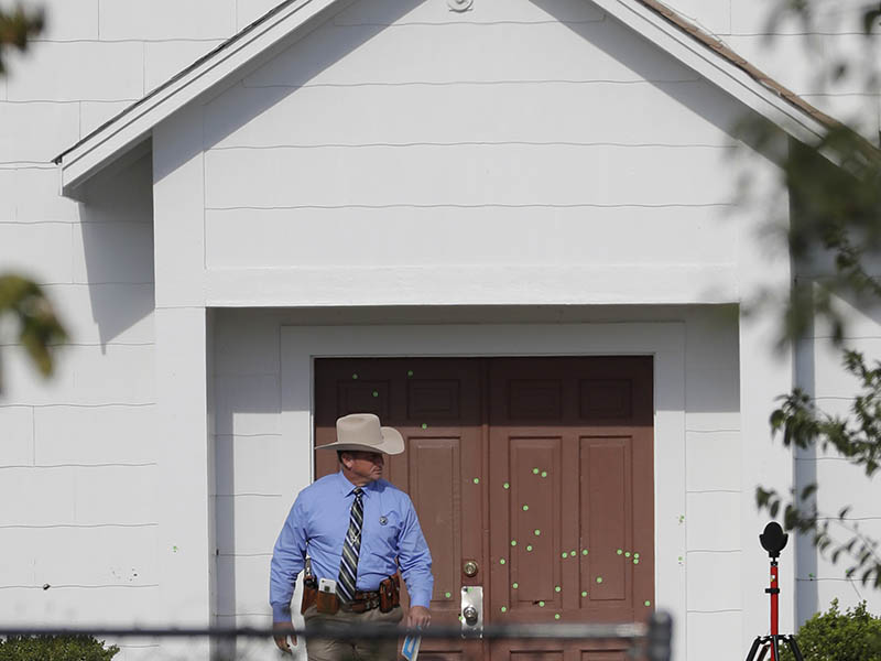 A law enforcement official leaves the First Baptist Church on Nov. 7, 2017, in Sutherland Springs, Texas. A man opened fire inside the church in the small South Texas community on Sunday, killing more than two dozen and injuring others. (AP Photo/David J. Phillip)