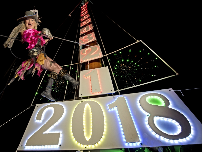 In this Saturday, Dec. 30, 2017, photo, Evalena Worthington practices her New Year's Eve descent from the top of a tall sailing vessel's mast, in Key West, Fla. The lowering of the pirate wench a Key West tradition (Rob O'Neal/Florida Keys News Bureau via AP)