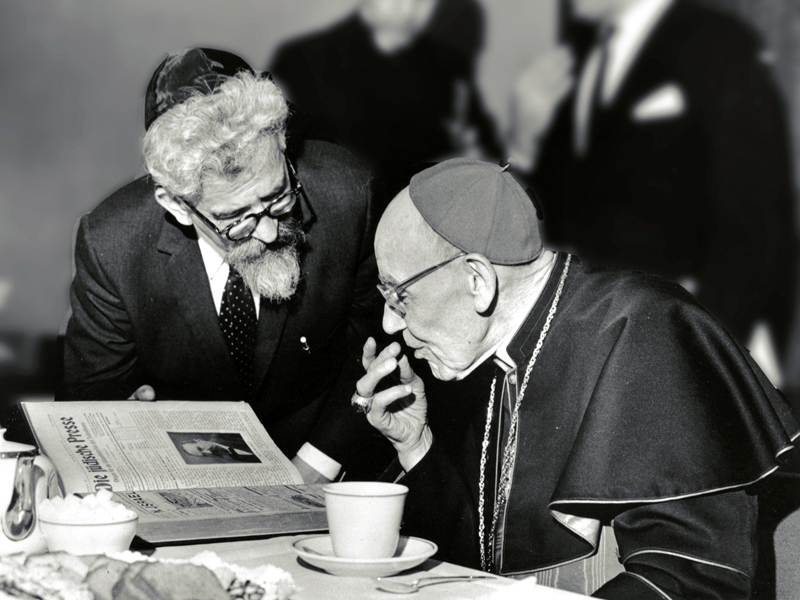 Rabbi Abraham Joshua Heschel meeting in New York with Cardinal Augustine Bea, who shepherded the process of Catholic introspection that led to Nostra Aetate, on March 31, 1963. (Photo courtesy of American Jewish Committee)