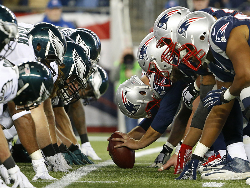 The New England Patriots and the Philadelphia Eagles at the line of scrimmage for the snap during an NFL football game at Gillette Stadium in Foxborough, Mass., on Dec. 6, 2015. (Winslow Townson/AP Images for Panini; caption amended by RNS)