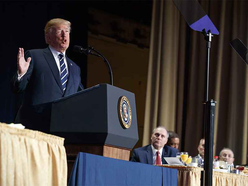 President Trump speaks during the National Prayer Breakfast, Thursday, Feb. 8, 2018, in Washington, with Steve Scalise at right. (AP Photo: Evan Vucci)