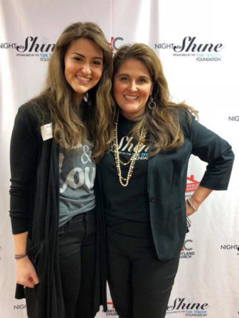 """Ginger Moore, right, and her daughter Georgia Leigh Moore, pose at a """"Night to Shine"""" event at Heartland Church in Paducah, Ky., on Feb. 9, 2018. The Moores pinned boutonnieres on the special-needs """"kings"""" who participated in the prom-night experience for teens and adults with special needs. Photo courtesy of Ginger Moore"""