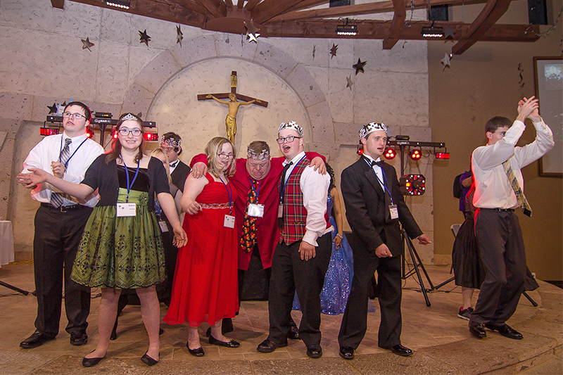 """Guests dance during a 2017 """"Night to Shine"""" event at a church. Photo by Scott Wagner/Creative Commons"""