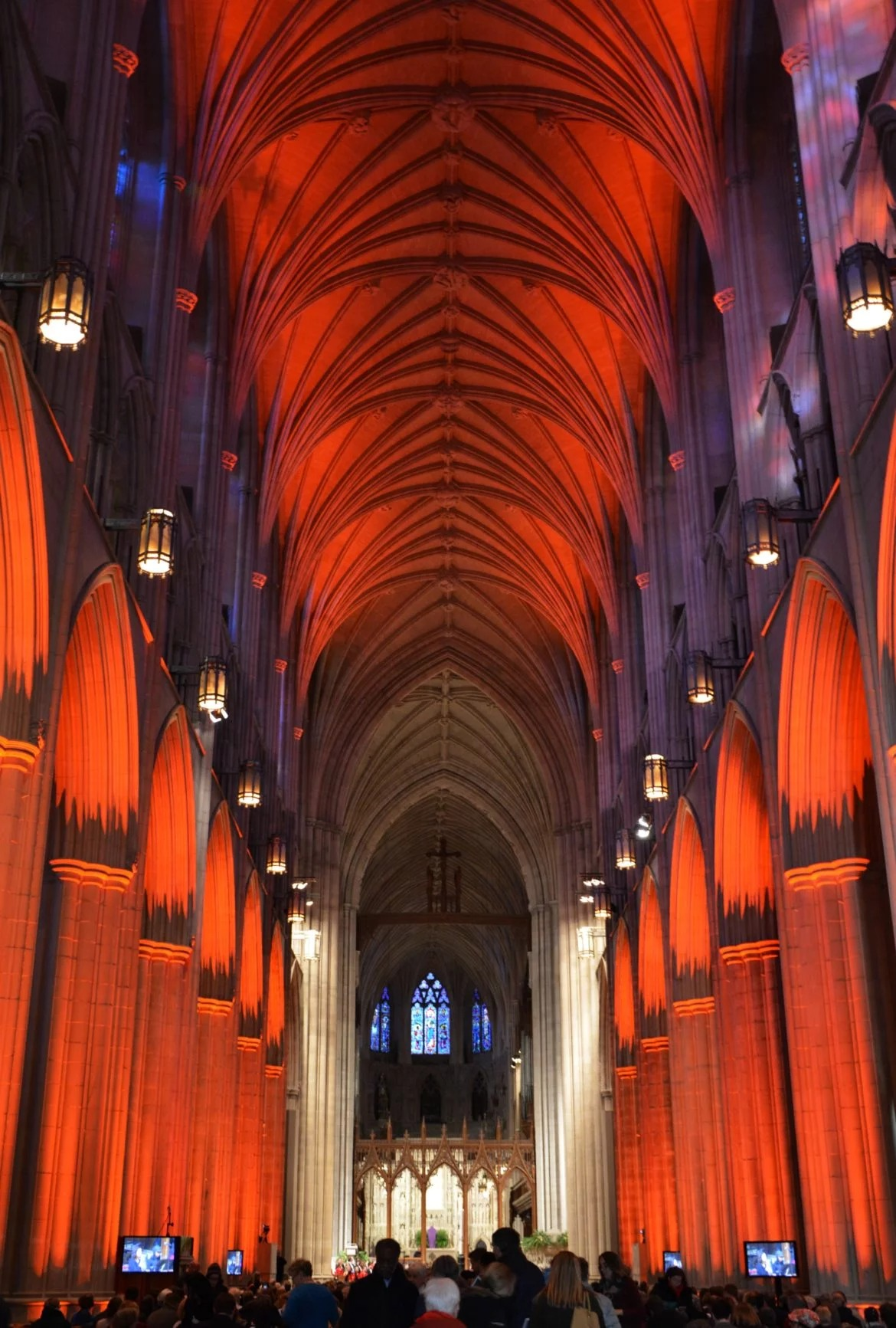 Orange lights illuminate the Washington National Cathedral during a vigil for gun violence victims on March 23, 2018. The vigil was held ahead of the March for Our Lives demonstration. RNS photo by Jack Jenkins.