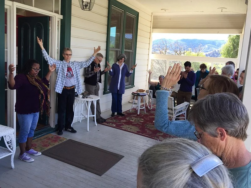 Venice Williams, left, leads Christian, Jewish and Muslim farmers in prayer at the FaithLands gathering on March 8, 2018, in Paicines, Calif. Williams is the founder of Alice's Garden in Milwaukee, where she presides over a house church that grew out of the garden and its community. RNS photo by Kimberly Winston