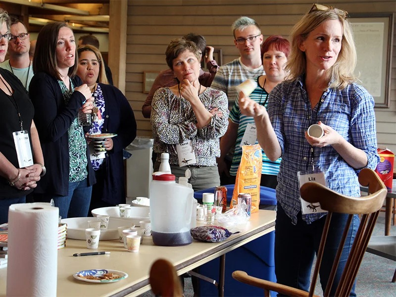 Liz Heinecke, right, demonstrates a science experiment for attendees during the Jesus Rode A Dinosaur conference on May 8, 2018, in Minneapolis. RNS photo by Emily McFarlan Miller