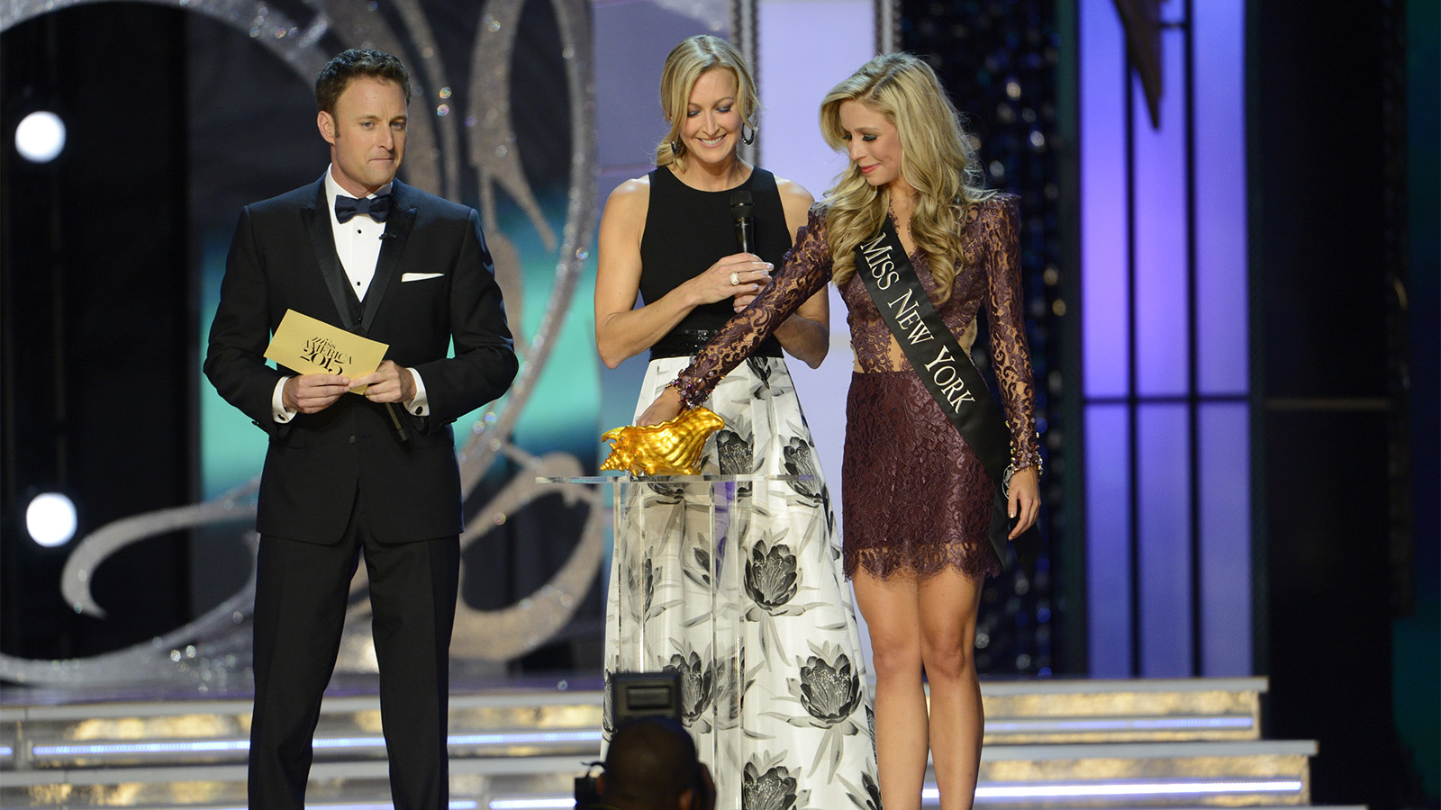 Hosts Chris Harrison, from left, and Lara Spencer with winner Miss New York Kira Kazantsev during the Miss America 2015 pageant on Sept. 14, 2014. Photo by Ida Mae Astute, courtesy of ABC
