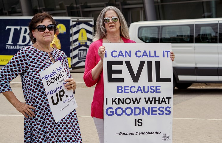 "Participants of the ""For Such a Time as This Rally"" hold signs outside of the Kay Bailey Hutchison Convention Center on June 12, 2018, on the first day of the two-day Southern Baptist Convention annual meeting in Dallas. The rally calls for Southern Baptist clergy to receive training on how to treat women with respect, how to handle allegations of abuse, and how to minister to victims of abuse. Photo by Marc Ira Hooks via Baptist Press"