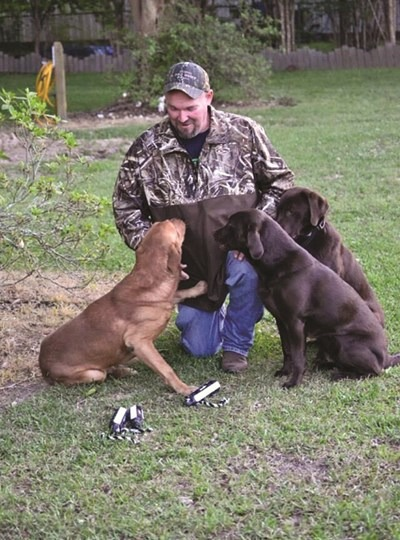 Johnny Morgan uses his three Labrador retrievers for visual illustrations and humor to convey timeless biblical truths in sharing the Gospel. (Submitted photo)
