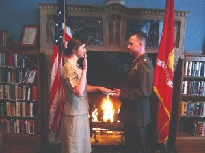 Alan Rogers commissions daughter Sarah Greenfield as an Ensign into the Chaplain Candidate Program in the library of the Marine Memorial Hotel in San Francisco, Calif., in December 2012. The Navy program is for prospective chaplains to explore chaplaincy and gain experience during seminary.